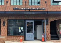 Green Brothers Juice Company Sign