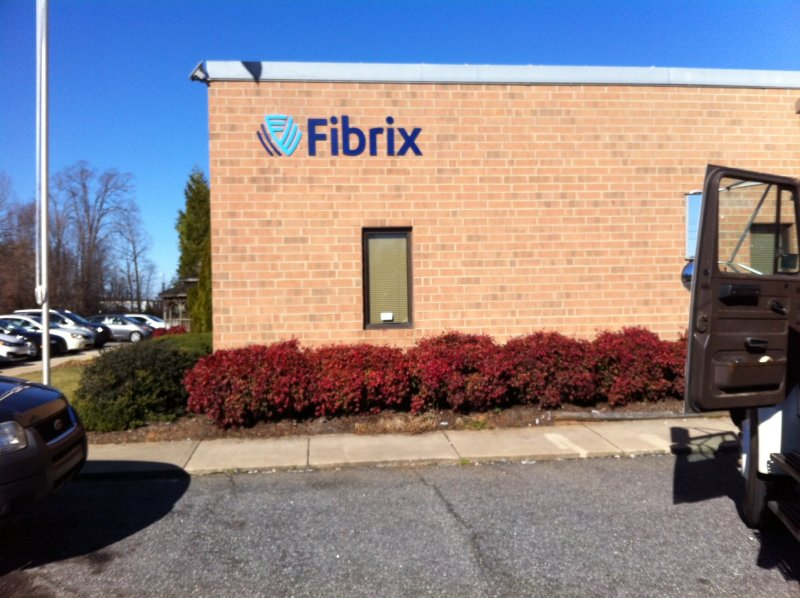 Stud-Mounted, Custom-Painted Sign Letters with Custom Logo at Fibrix in Conover, North Carolina