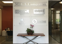 Brushed Aluminum Dimensional Letter Signs mounted on Clear Acrylic Panels with Brushed Aluminum Stand Off Hardware