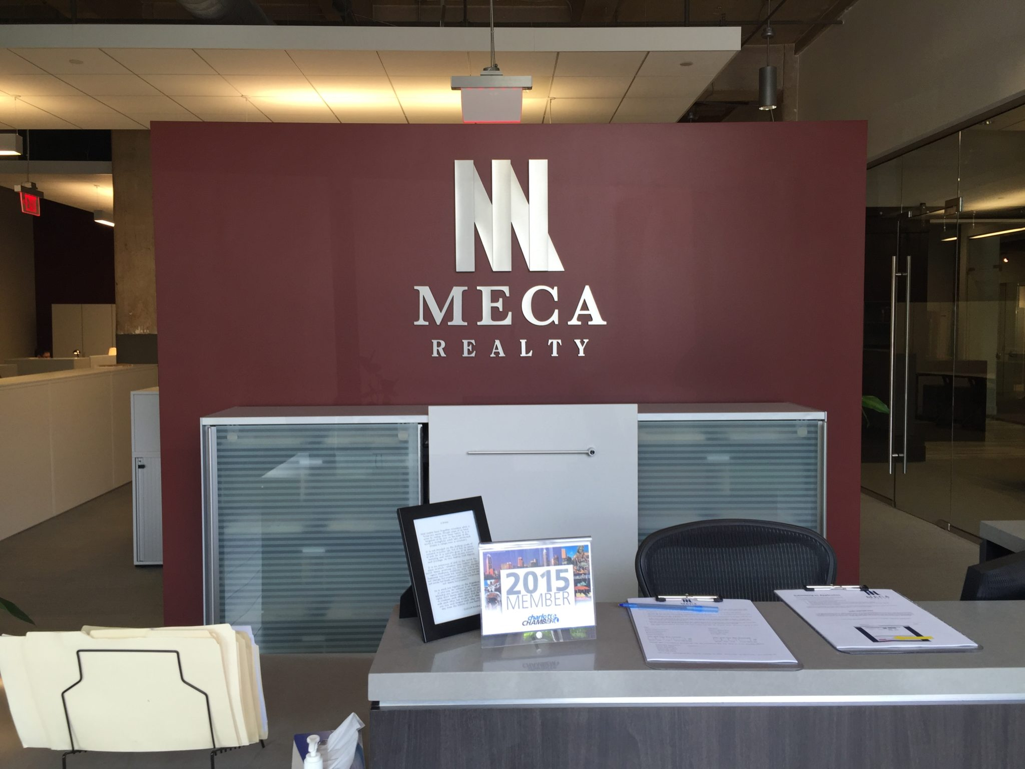 Brushed aluminum dimensional letters with vinyl overlays for Interior design charlotte nc