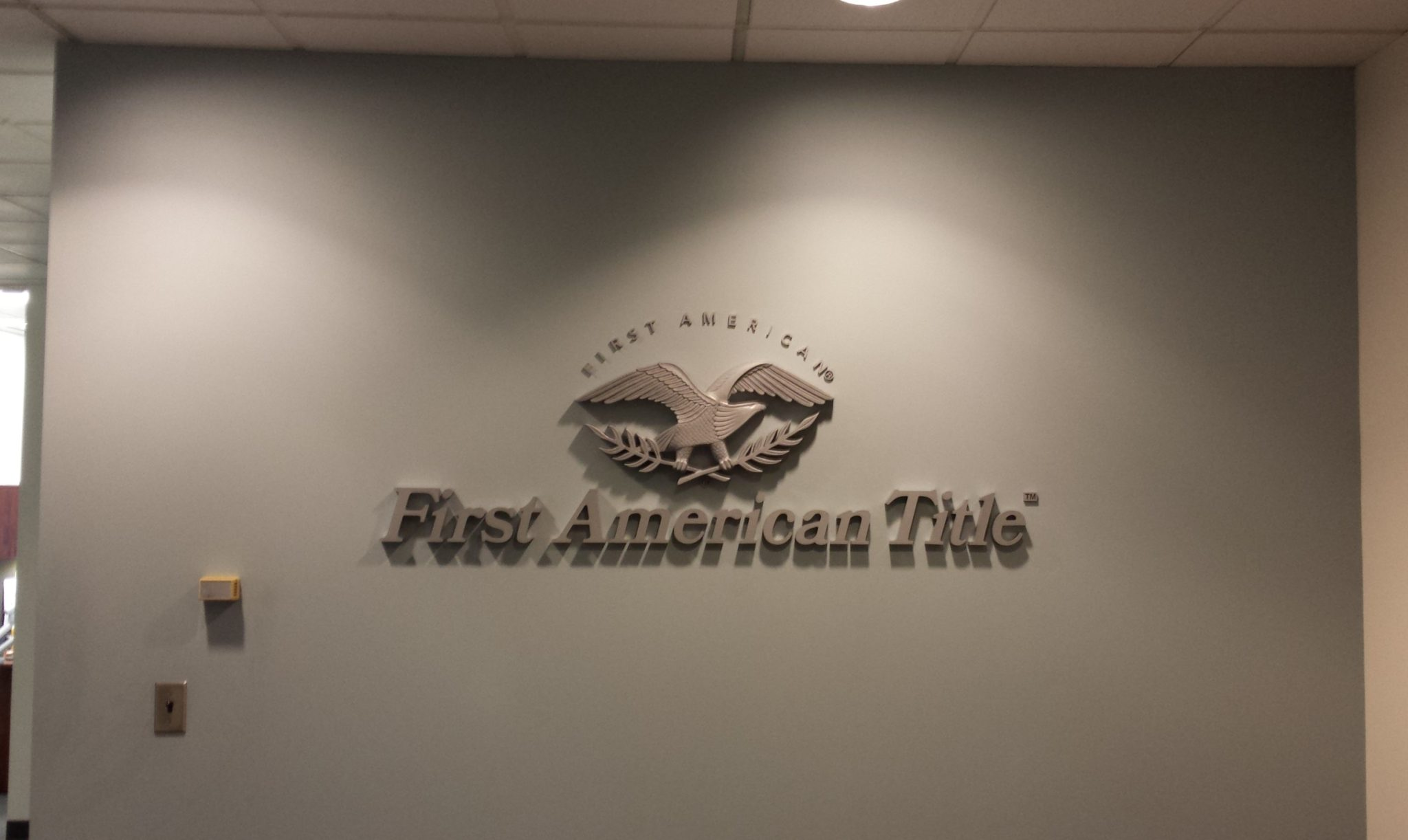 interior feature wall sign for first american title company