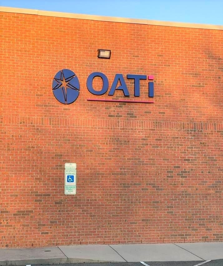 OATi Reverse Channel Letter Sign with Logo Graphic