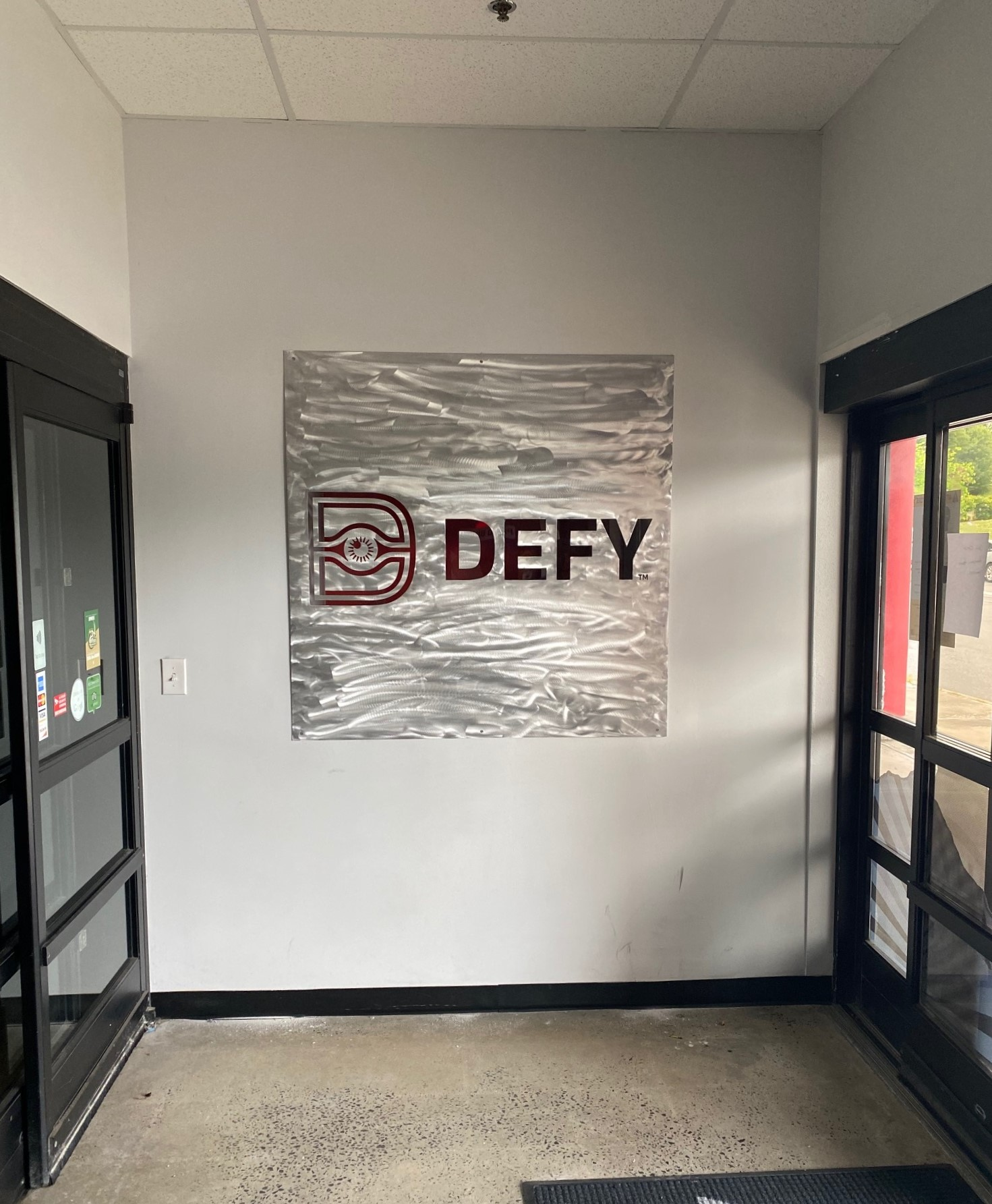 Defy Gravity -- Interior Lobby Sign