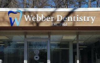 Webber Dentistry Sign - Painted Acrylic & Stud-Mounted with Logo