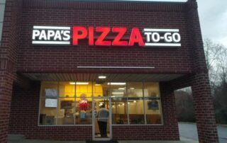 Papa's Pizza Sign by Night