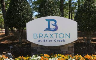 Custom Monument Sign with Brick Base and Dimensional Acrylic Graphics